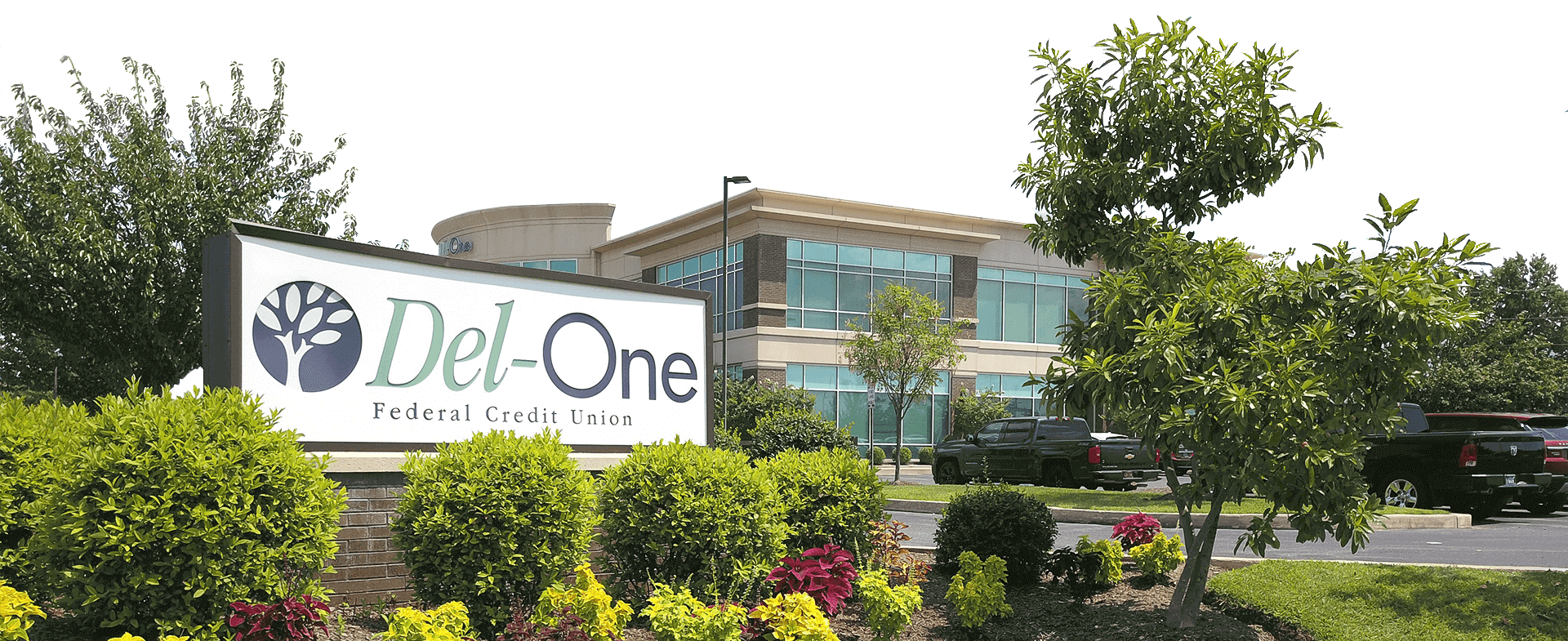 Image of an outdoor banner of Del-One FCU