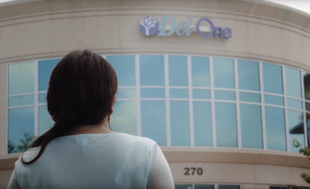 Image of client in front on Del-One branch