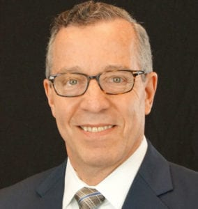 Ron Baron, President and Chief Executive Officer of Del-One Federal Credit Union