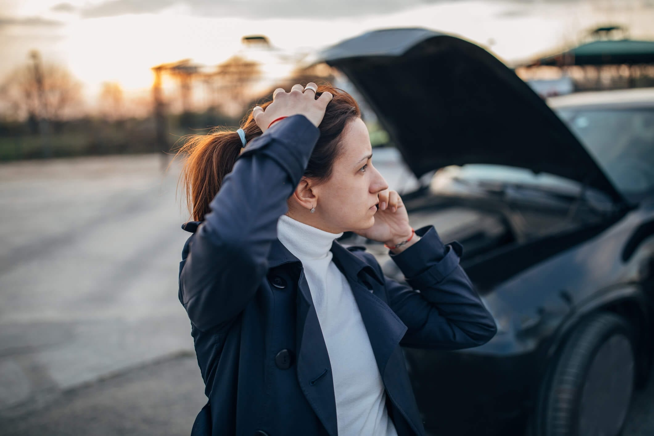 Stressed woman with car