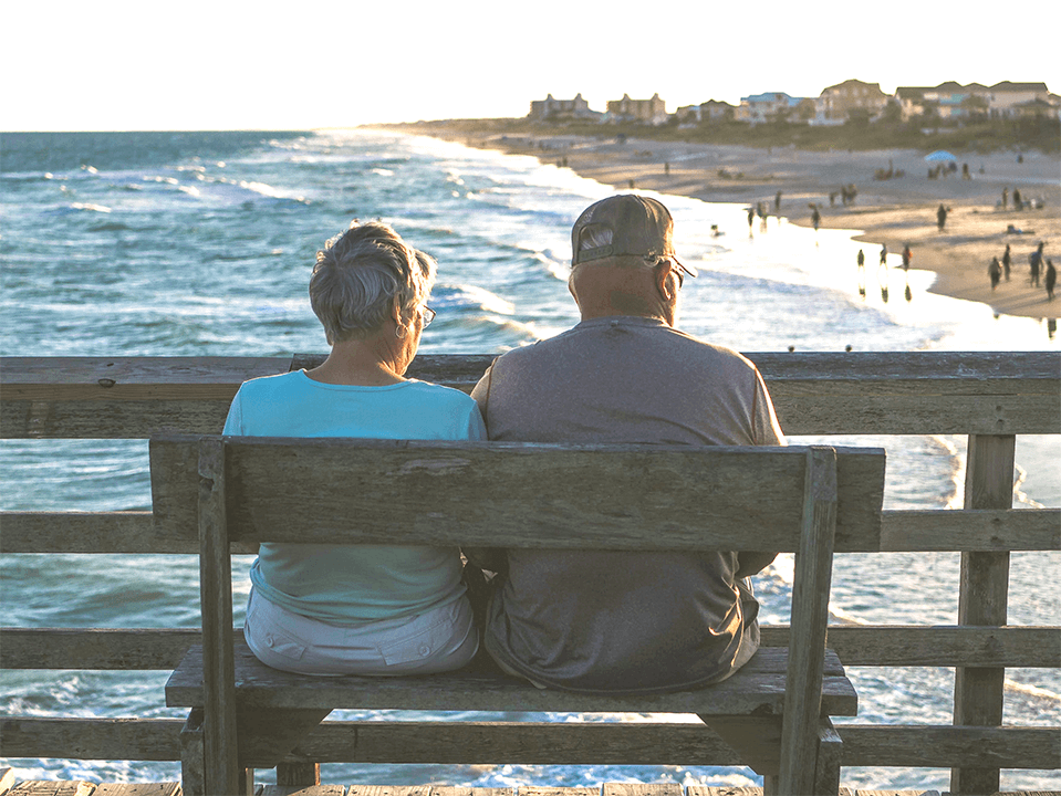 Older couple sitting on pier