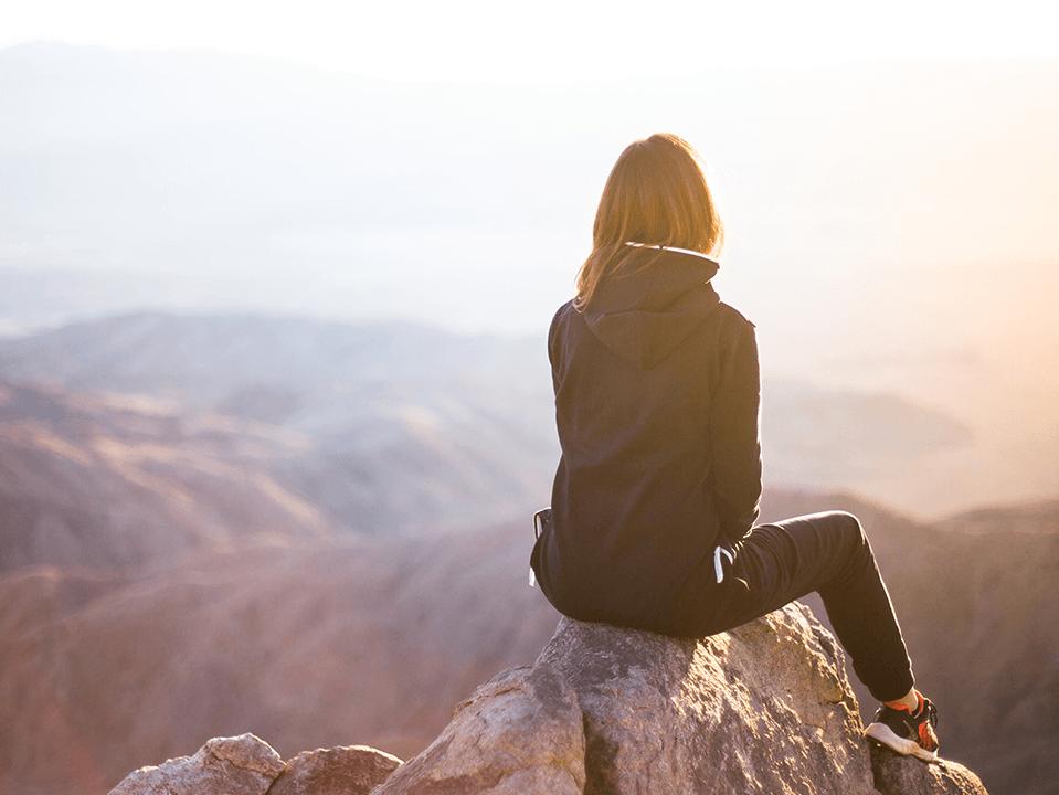 Girl on mountain top
